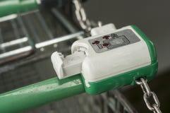 Coin burglar on supermarket trolleys alignment. Closeup of coin burglar on supermarket trolleys alignment Stock Photos