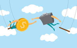 Coin and business suitcase swinging on flying trapeze Stock Image