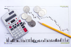 Coin calculator and pen Stock Photos