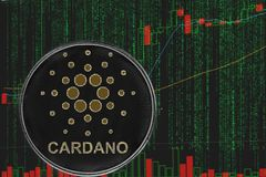 Token ADA cardano cryptocurrency on the background of binary crypto matrix text and price chart. Coin cardano ada cryptocurrency on the background of binary royalty free stock photo