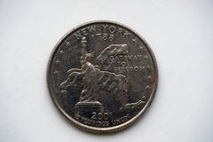 Coin 25 cents - `Washington Quarter` New York. 1/4 Dollar `Washington Quarter` New York. Reverse. The Statue of Liberty against a map of the state displaying a royalty free stock photos