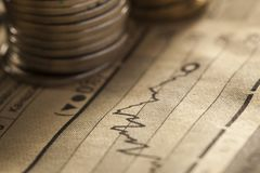 Coin and chart business concept. Coin and chart a business concept Royalty Free Stock Photos