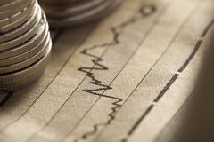 Coin and chart business concept. Coin and chart a business concept Royalty Free Stock Images
