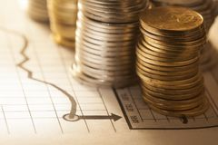 Coin and chart business concept. The coin and chart a business concept Royalty Free Stock Photos