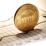 Coin on chart Stock Photo