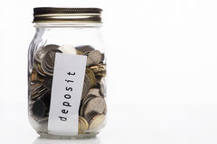 Coin in clear bottle, saving concept Royalty Free Stock Image