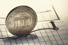 Coin and clock on chart stock image