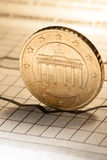 Coin and clock on chart royalty free stock image