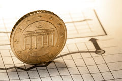 Coin and clock on chart stock photos