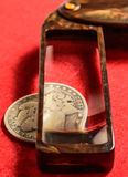 Coin collecting Morgan silver dollar and old magnifying glass Royalty Free Stock Image