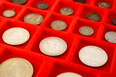 Coin collection 1. A coin collection on red velvet Royalty Free Stock Photos