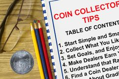 Coin collectopr tips. Coin collector tips  with topics on a cover sheet Royalty Free Stock Images