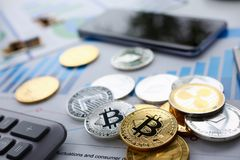 Coin crypto currency bitcoin lies on the keyboard. Coin crypto currency bitcoin lies on calculator keyboard background theme silver exchange pyramid for money royalty free stock photography