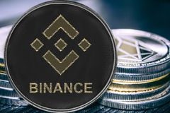 Coin cryptocurrency binance on the background of a stack of coins. BNB stock photo
