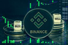 Coin cryptocurrency bnd stack of coins and dice. Exchange chart to buy, sell, hold. The coin cryptocurrency bnb binance stack of coins and dice. Exchange chart royalty free illustration