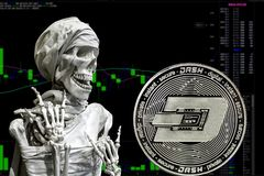 Coin cryptocurrency Dash and skeletonon a background chart. stock photos