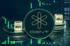 Coin cryptocurrency Dent stack of coins and dice. Exchange chart to buy, sell, hold. The coin cryptocurrency Dent stack of coins and dice. Exchange chart to buy stock image