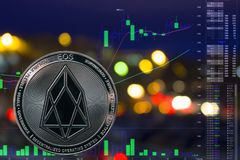 Coin cryptocurrency EOS on night city background and chart. The coin cryptocurrency EOS on night city background and chart stock images