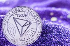 Coin cryptocurrency Tron on modern neon background. trx. Coin cryptocurrency Tron and neon fabric background. trx royalty free stock images