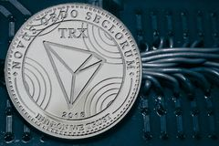 Coin cryptocurrency TRX on the background of wires and circuits. royalty free stock image