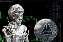Coin cryptocurrency TRX and skeletonon a background chart. royalty free illustration