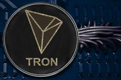 Coin cryptocurrency TRX Tron on the background of wires and circuits. The coin cryptocurrency Tron on the background of wires and circuits. Token TRX royalty free stock images