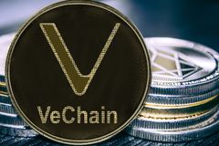 Coin cryptocurrency VeChain VET on the background of a stack of coins. MKR stock photos