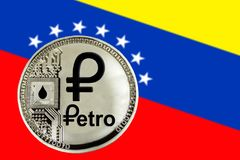 Coin Cryptocurrency Venezuela Petro. On the background of the flag of Venezuela stock photography