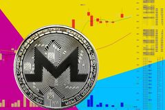 Coin cryptocurrency XMR on chart and yellow blue neon background. Coin cryptocurrency Monero on chart and yellow blue neon background royalty free stock image