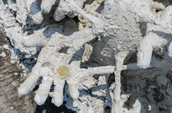 Coin in the dead hand Stock Photo