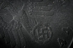 Coin detail money of third reich nazi Germany. Background texture corroded metal of old nazi pfennig 1944. Rough grained surface. Surface of old dark nazi coin Stock Image