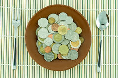 Coin on dishware Stock Image