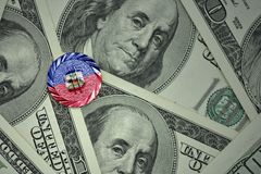 Coin with dollar sign with national flag of haiti on the dollar money banknotes background. Finance concept Stock Image