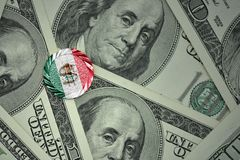 Coin with dollar sign with national flag of mexico on the dollar money banknotes background. Finance concept Royalty Free Stock Photos