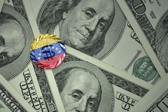 Coin with dollar sign with national flag of venezuela on the dollar money banknotes background. Finance concept Stock Photography