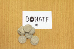 Coin and  donate money. Coin and the note with donate money Royalty Free Stock Photography