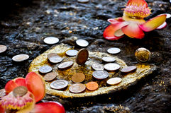 Coin donation in the Buddha's footprint,Thailand Stock Photography