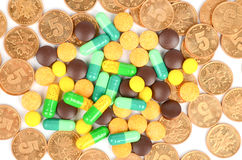 Coin and drug Stock Photo