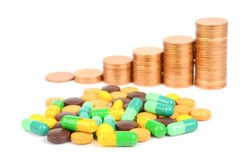 Coin and drug Royalty Free Stock Photography