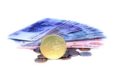 Coin euro on banknotes Royalty Free Stock Image