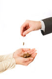 Coin fall from ona hand to other. Coin fall from masculine hand to female hands stock images