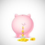 Coin falling from Piggy Bank Royalty Free Stock Photo
