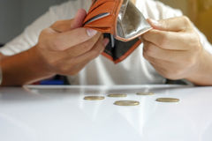 Coin falling from wallet - Little money concept. Closeup royalty free stock photo