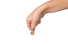 Coin in female hand Royalty Free Stock Photo