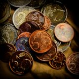 Coin of five euro cents lies on the background of coins. Euro mo. Ney.  Currency of the European Union Stock Photo