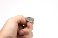 Coin Flip. A hand holding a quarter, just about to flip a coin royalty free stock image