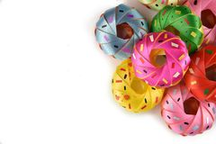 Coin folding with Ribbon is shaped a colorful Donut  on white background for ordination scatter ceremony of buddhism./ Don Stock Image