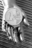 Coin of futuristic metallic silver hand Royalty Free Stock Photo