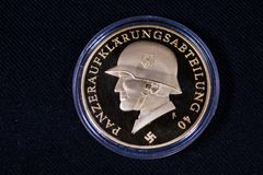 1940 Nazi Germany Third Reich Coin. A coin from Germany circa 1940 with a German soldier with helmet and swastika. History, historic, World War II coin made of stock images