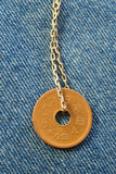 Coin on the golden chain Royalty Free Stock Photos
